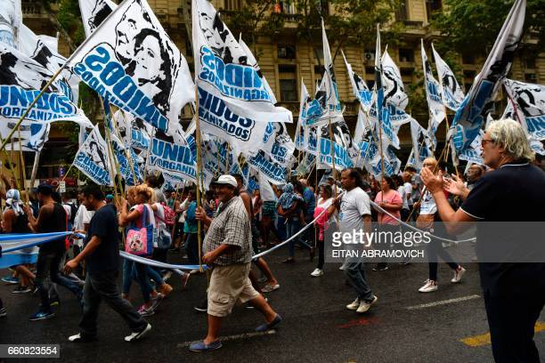 Protesters march toward the Plaza de Mayo square during a demonstration called by the Argentine Central Workers union against President Mauricio...