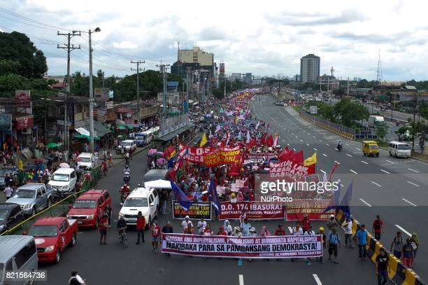 Protesters march towards Congress during a rally coinciding President Rodrigo Duterte's annual State of the Nation Address in Quezon City northeast...