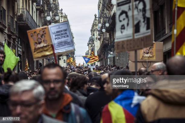 Protesters march with photographs of Catalan activists Jordi Sanchez and Jordi Cuixart and call for 'Freedom for political prisoners' during a...