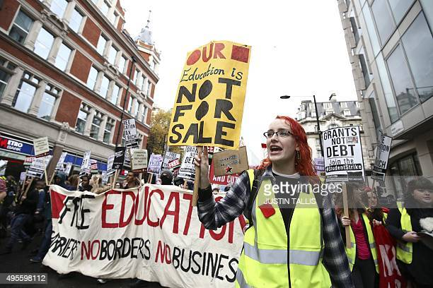 Protesters march with placards and banners against student fees during an annual demonstration in central London on November 4 2015 Students marched...