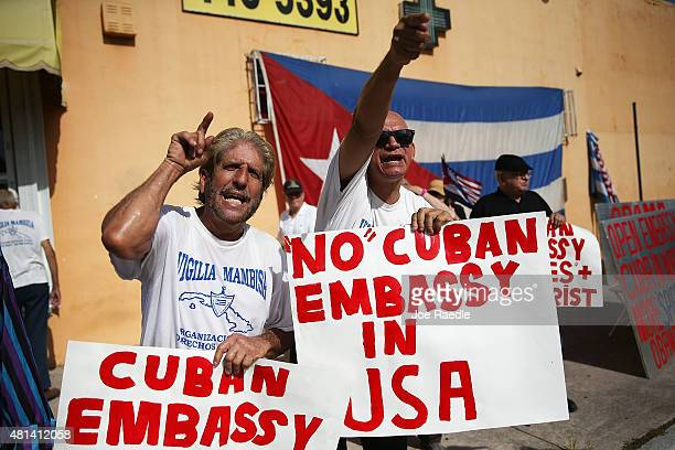 Protesters Miguel Saavedra and Osvaldo Hernadez show their displeasure in the Little Havana neighborhood with the normalization of the Cuban/United...