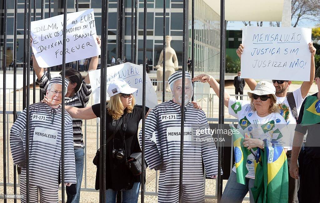 Protesters mock to hang dummies representing Jose Dirceu former Chief of Staff of President Luiz Inacio Lula da Silva and and Jose Genoino former...
