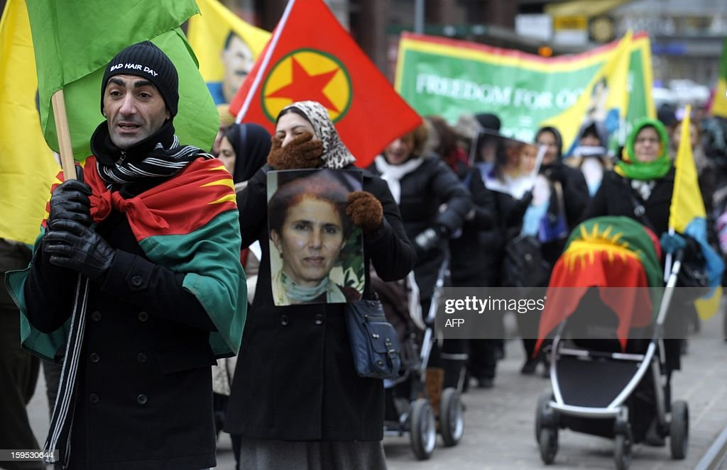 Protesters of Kurdish origin gather in Helsinki, on January 15, 2013 to protest after the killing of three Kurdish activists in Paris. The jailed leader of Turkey's Kurd rebels, Abdullah Ocalan, condemned the killing of three Kurdish women activists in Paris, one of them a longtime comrade, the Anatolia news agency reported, quoting his brother. AFP PHOTO/ LEHTIKUVA / Trond H. Trosdahl FINLAND OUT
