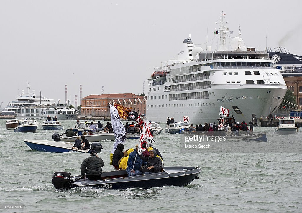 Protesters on small boats block the exit from Venice Port of large cruises delaying their departure for several hours on June 9, 2013 in Venice, Italy. Three days of protests are being organised by Venetians and environmentalists, who are opposed to cruise ships crossing the St Mark's Basin.