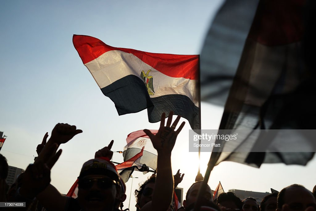 Protesters opposed to ousted Egyptian President Mohamed Morsi celebrate in Tahrir Square on July 6 2013 in Cairo Egypt Over 17 people were killed in...