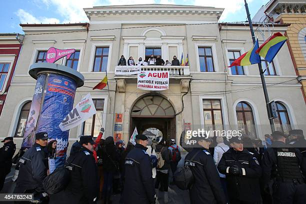 Protesters opposing the mining law to be voted on by the Romanian Parliament occupy the building where are seated regional party branches of the...