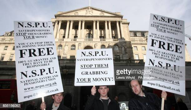 Protesters outside the Bank of England on the day the bank is expected to make a decision on the level of interest rates