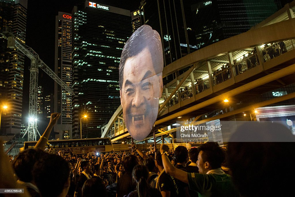 Protesters parade a large cut out of the head of CY Leung in the streets outside the Hong Kong Government Complex on September 29 2014 in Hong Kong...