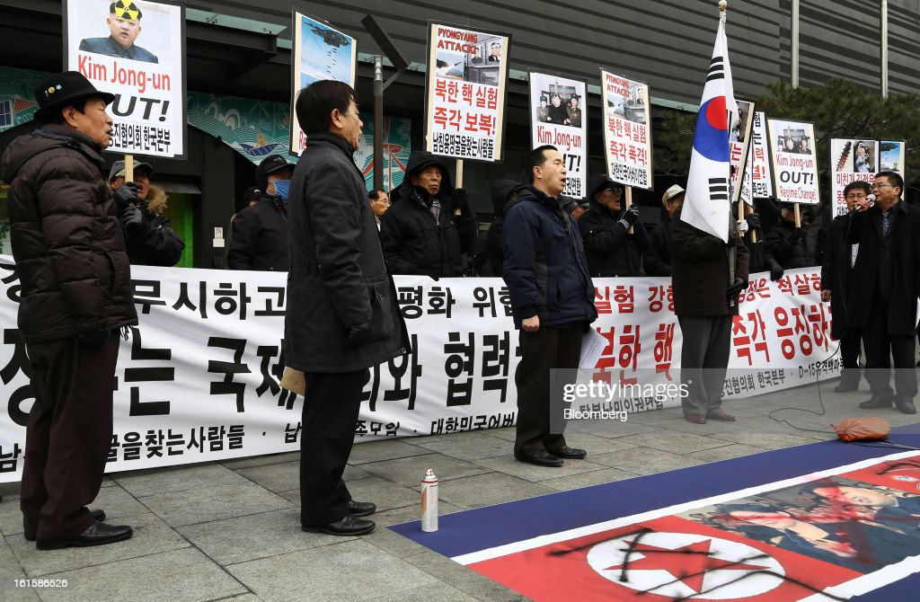 Protesters participate in a demonstration against North Korea's nuclear test in Seoul, South Korea, on Tuesday, Feb. 12, 2013. North Korea conducted its third underground nuclear test today, underscoring a disregard for an international community that has already isolated the totalitarian state from the global economy. Photographer: SeongJoon Cho/Bloomberg via Getty Images