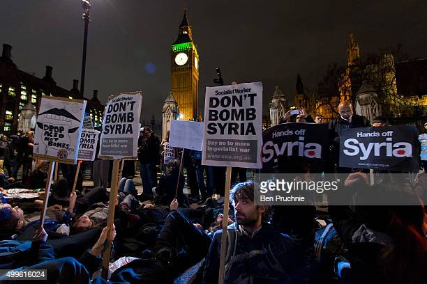 Protesters participate in a 'Die In' protest in Parliament Square on December 2 2015 in London England ritish MPs are expected to vote tonight on...