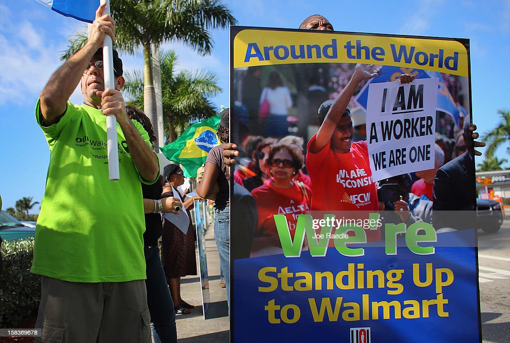 Protesters participate in a 'Global Day' of action against Walmart on December 14, 2012 in Hialeah, Florida. The protesters in partnership with the global union federation UNI, the union-affiliated group Making Change at Walmart joined others around the world to among other things call for an end to alleged retaliation against US Walmart worker activists.