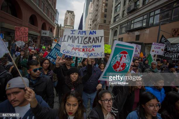 Protesters participate in the Immigrants Make America Great March to protest actions being taken by the Trump administration on February 18 2017 in...