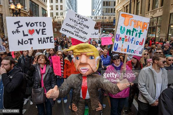Protesters participate in the Women's March on January 21 2017 in Chicago Illinois Thousands of demonstrators took to the streets in protest after...