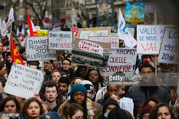 Protesters placards as they take part in a demonstration called by youth organisations and students' unions on March 9 in Paris during a nationwide...