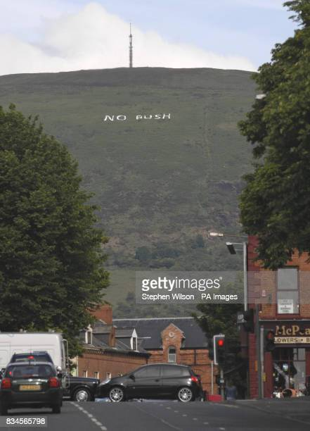 Protesters place a large 'No Bush' sign on the Black Mountain which overlooks the city of Belfast ahead of the visit of US President George Bush to...