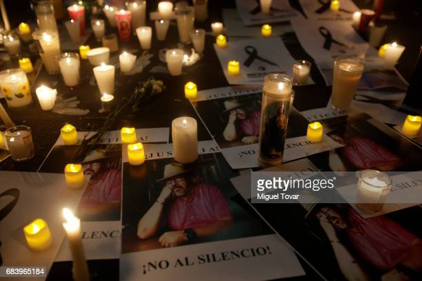 Protesters place signs and candles during a demonstration after the Mexican journalist Javier Valdez murder at Secretary's of Interior on May 16 2017...