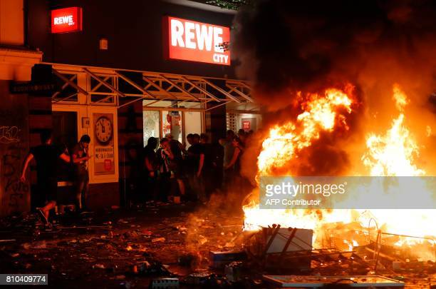 Protesters plunder a Rewe supermarket on July 7 2017 in Hamburg northern Germany where leaders of the world's top economies gather for a G20 summit...