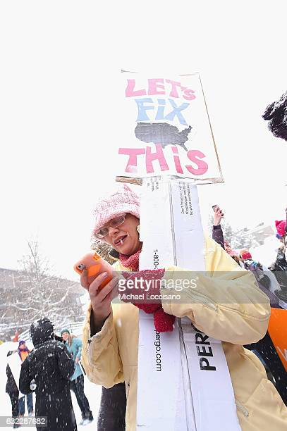Protesters pose at the start of the Women's March on Main Street Park City on January 21 2017 in Park City Utah