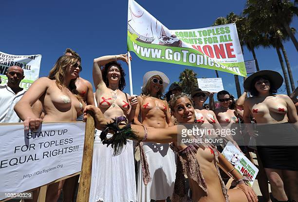 Protesters pose during the 'National Go Topless Day' to honor Women's Equality Day at Venice Beach in Los Angeles on August 22 2010 The annual...