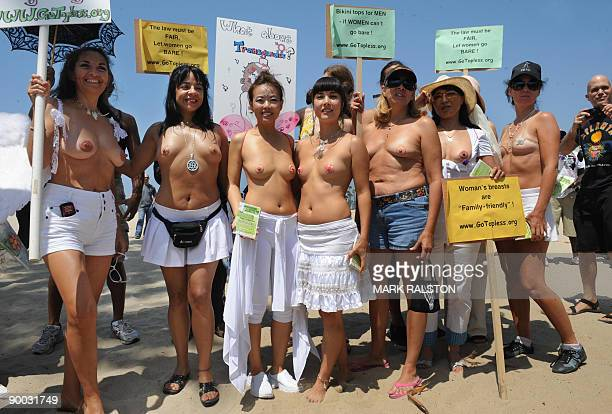 Protesters prepare to march during 'National Go Topless Day' to honor Women's Equality Day at Venice Beach in Los Angeles on August 23 2009 The...