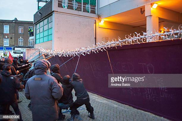 Protesters pulling down the fence surrounding the Aylesbury council estate in Southwark South London In the estate which will be demolished soon used...