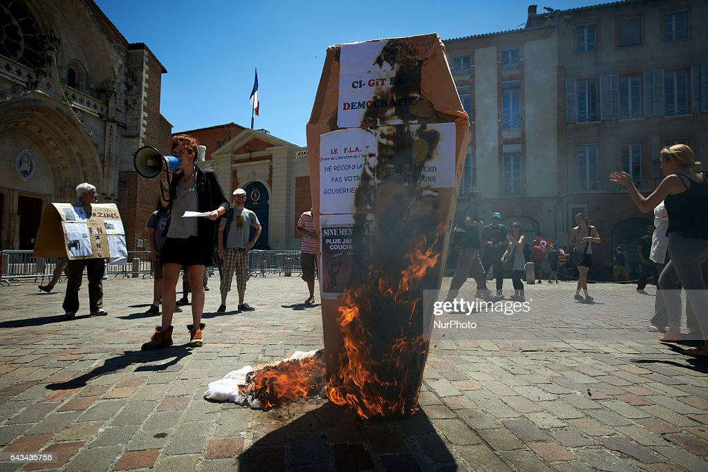 Protesters put on fire the false coffin symbolizing democracy they bring in front of the Prefecture at the end of a protest against the El-Khomri bill on labour reforms the day the bill go through the Senate. They also protest against the use of article 49.3 which bypass the Parliament. The prefecture is a symbol of the State in France. Toulouse. France. June 28th, 2016.