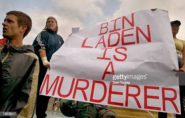 Protesters raise a banner condemning Osama Bin Laden August 25 2002 during a 'Rally For Islam' demonstration held by AlMuhajiroun a UK based Muslim...