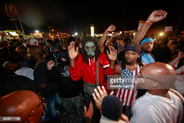 Protesters raise hands during a demonstration on August 18 2014 for Michael Brown who was killed by a police officer on August 9 in Ferguson United...