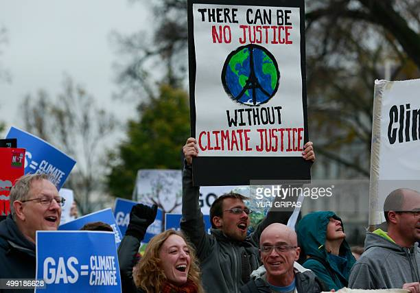 Protesters rally about climate change outside the White House in Washington DC on November 29 2015 Hundreds of thousands of people rallied around the...