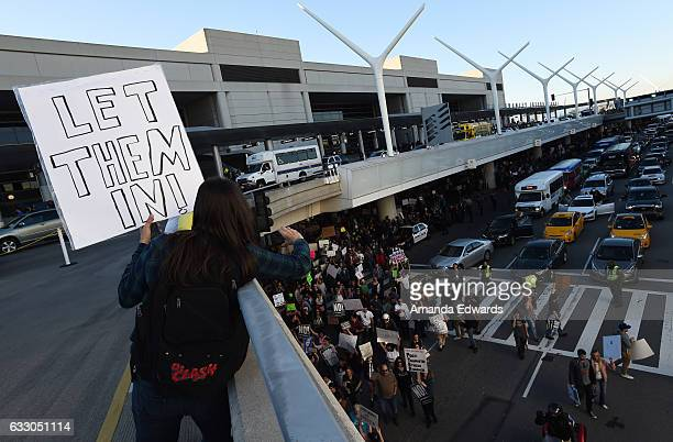 Protesters rally against the Muslim immigration ban imposed by US President Donald Trump at Los Angeles International Airport on January 29 2017 in...