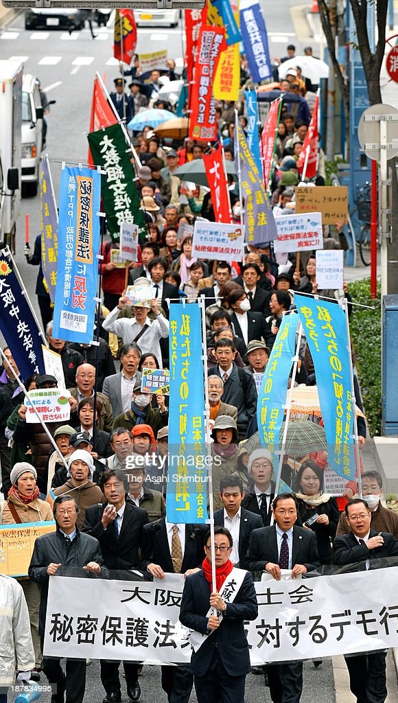 Protesters rally against the proposed state secrets protection law march on November 12, 2013 in Osaka, Japan. The deliberations on the state secrets protection bill, which will toughen penalties on public servants who leak 'specified secrets' that could jeopardize Japan's national security, is under way at the diet. Under the bill, public servants and other individuals can be imprisoned for up to 10 years if they disclose specified secrets.