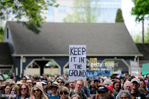Protesters rally ahead of the People's Climate March in Portland Ore United States on April 29 2017 Thousands turned out in solidarity with actions...