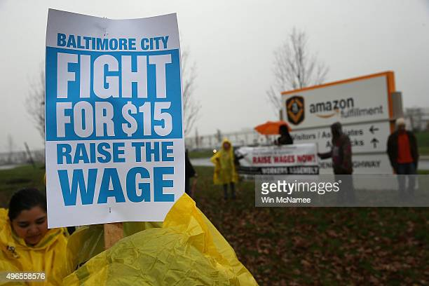 Protesters rally at a 'Fight for $15 Day of Action' protest outside of an Amazon fulfillment center on November 10 2015 in Baltimore Maryland Local...