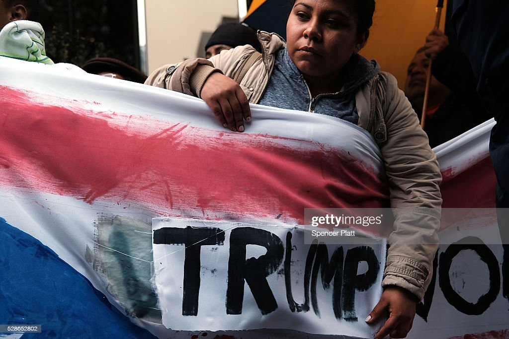 Protesters rally in front of a Trump owned hotel in Manhattan on May 06, 2016 in New York City. The protesters, many of them Latino and Puerto Rican workers, are voicing their disapproval of Donald Trump's statements on the Puerto Rican debt crisis. While Trump said he doesn't believe the struggling unincorporated U.S. territory should have to pay all that it owes, he does not support a bailout for the island and instead would like to see the debt restructured.