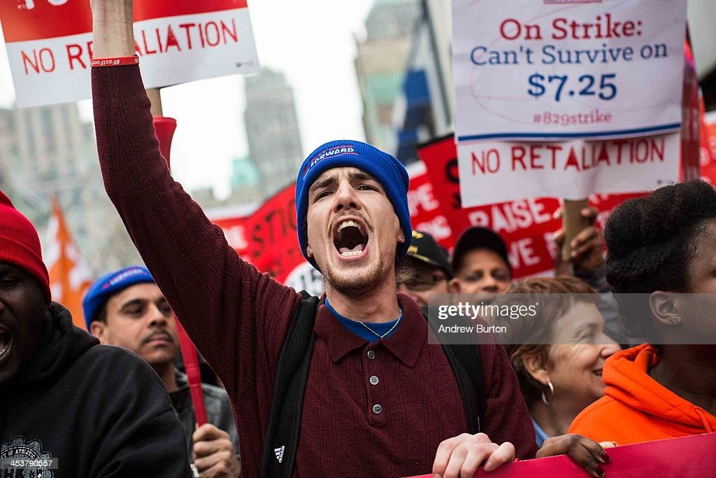 Protesters rally outside of a Wendy's in support of raising fast food wages from $7.25 per hour to $15.00 per hour on December 5, 2013 in the Brooklyn borough of New York City. A growing number of fast food workers in the United States have been staging protests outside restaurants, calling for a raise in wages, claiming it is impossible to live resonably while earning minimum wage.