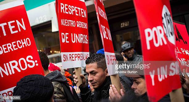 Protesters rally outside of a Wendy's in support of raising fast food wages from $725 per hour to $1500 per hour on December 5 2013 in the Brooklyn...