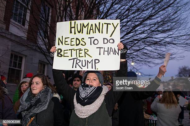 Protesters rally outside of the Flynn Center for the Performing Arts where Republican presidential frontrunner Donald Trump is hosting an event on...