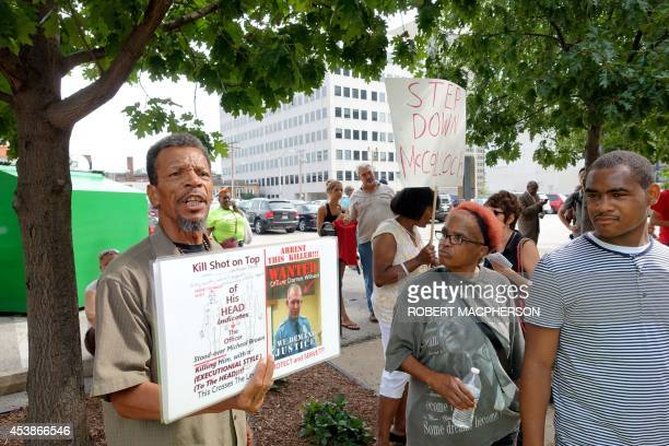 Protesters rally outside the office of St Louis County prosecutor Robert McCulloch on August 20 demanding the arrest of Darren Wilson the white...