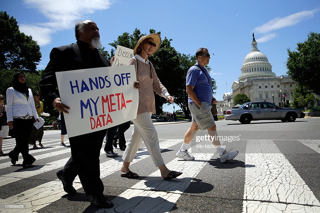 Protesters rally outside the US Capitol against the NSA's recently detailed surveillance programs June 13 2013 in Washington DC Members of various...
