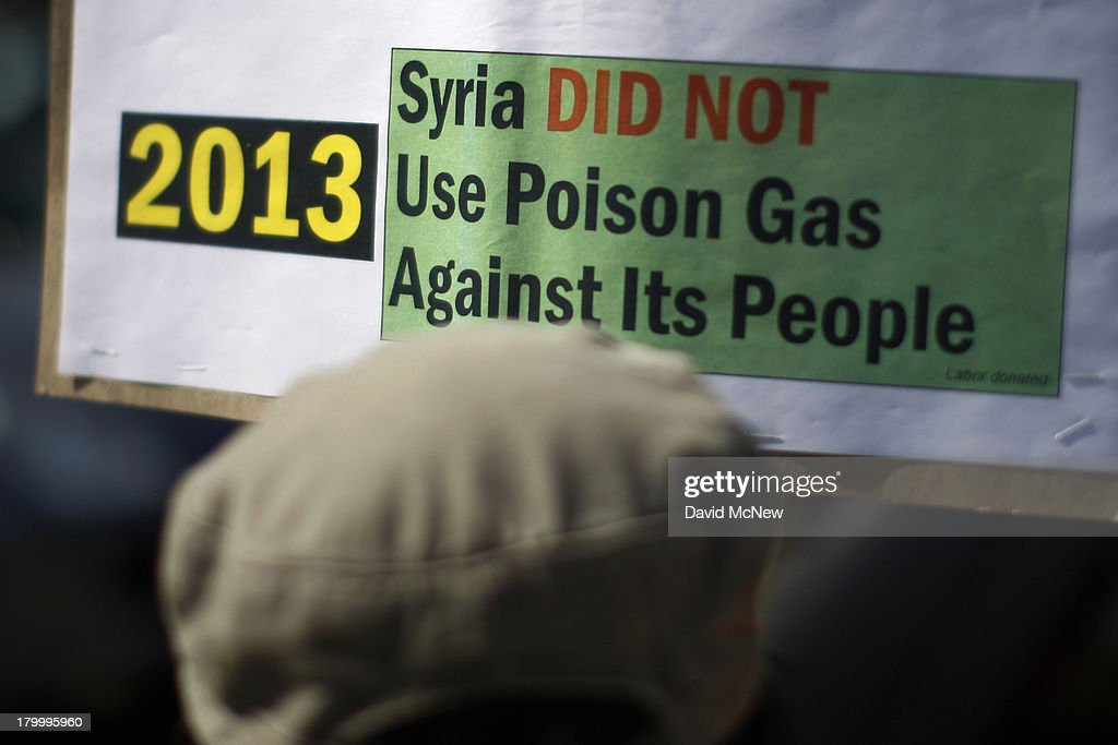 Protesters rally to urge Congress to vote against a limited military strike against the Syrian military in response to allegations that President Bashar Hafez al-Assad has used sarin gas to kill civilians on September 7, 2013 in Los Angeles, California. The Obama administration claims to have clear evidence that the Syrian military broke international law by killing nearly 1,500 Syrian civilians, including at least 426 children, in a chemical weapons attack on August 21, and is seeking the support of Congress for a missile strikes to prevent future chemical weapons attacks by the regime and other nations.