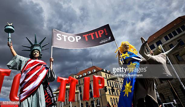 Protesters rallying against the TTIP and CETA free trade agreements march on the eve of a visit by US President Barack Obama on April 23 2016 in...
