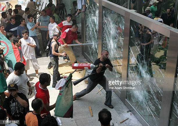 Protesters rampage at the United Nation facility after Israeli air attack hit Qana on July 30 2006 in Beirut Lebanon