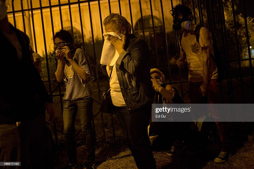 Protesters react after being teargassed in Istanbul Turkey on June 15 2013 After 18 days of antigovernment protests that presented a broad rebuke the...
