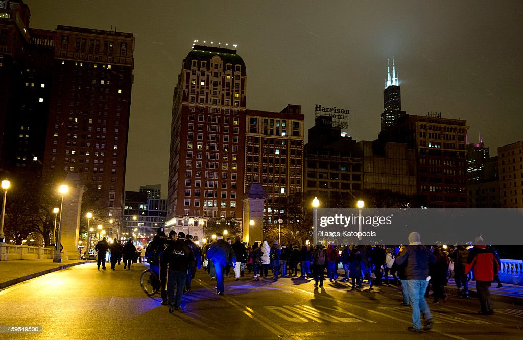 Protesters react to the St. Louis grand jury decision not to indict Ferguson Police Officer <a gi-track='captionPersonalityLinkClicked' href=/galleries/search?phrase=Darren+Wilson+-+Police+Officer&family=editorial&specificpeople=13495859 ng-click='$event.stopPropagation()'>Darren Wilson</a> in the shooting death of Michael Brown November 24, 2014 in Chicago, Illinois. Michael Brown was shot by Officer <a gi-track='captionPersonalityLinkClicked' href=/galleries/search?phrase=Darren+Wilson+-+Police+Officer&family=editorial&specificpeople=13495859 ng-click='$event.stopPropagation()'>Darren Wilson</a> on August 9, 2014, his death sparked riots in Ferguson Missouri in August.