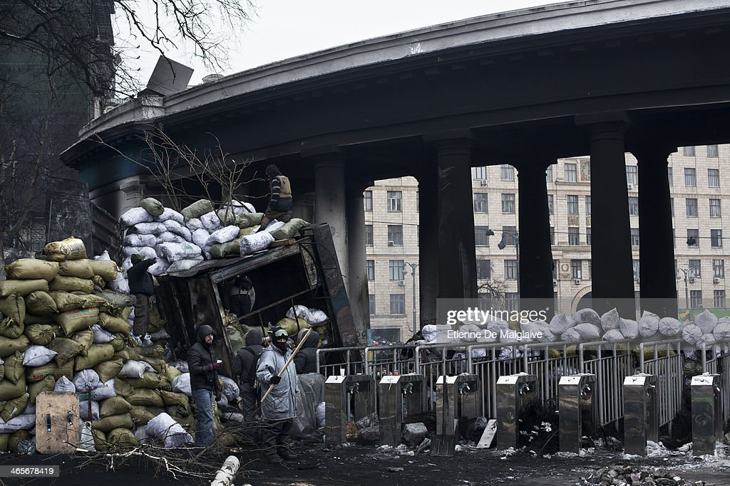 Protesters reinforce barricades around the Dynamo Stadium main gate on January 28, 2014 in Kiev, Ukraine. While Ukrainian parliament holds an emergency session, standoff continues on Hrushevskoho street between anti-government protesters and riot police.
