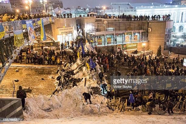 Protesters reinforcing a new much more substantial barricade near the entrance to Maidan Square on December 11 2013 in Kiev Ukraine Thousands have...