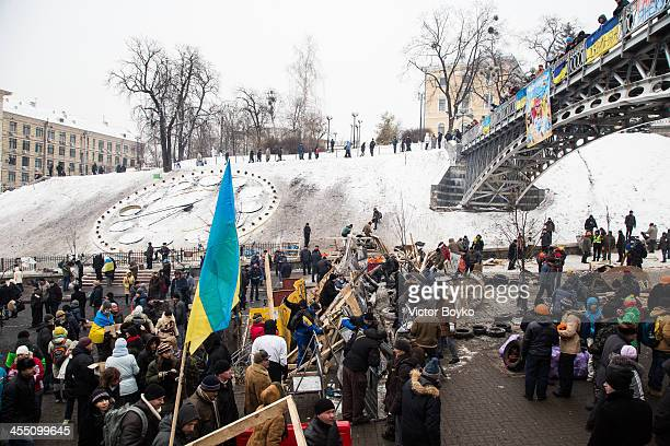 Protesters reinforcing barricades on Independence Square on December 11 2013 in Kiev Ukraine Riot police today tried to break into City Hall which is...