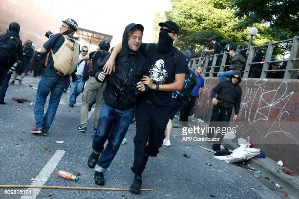 Protesters run after Riot police stormed the 'Welcome to Hell' rally against the G20 summit in Hamburg northern Germany on July 6 2017 Leaders of the...