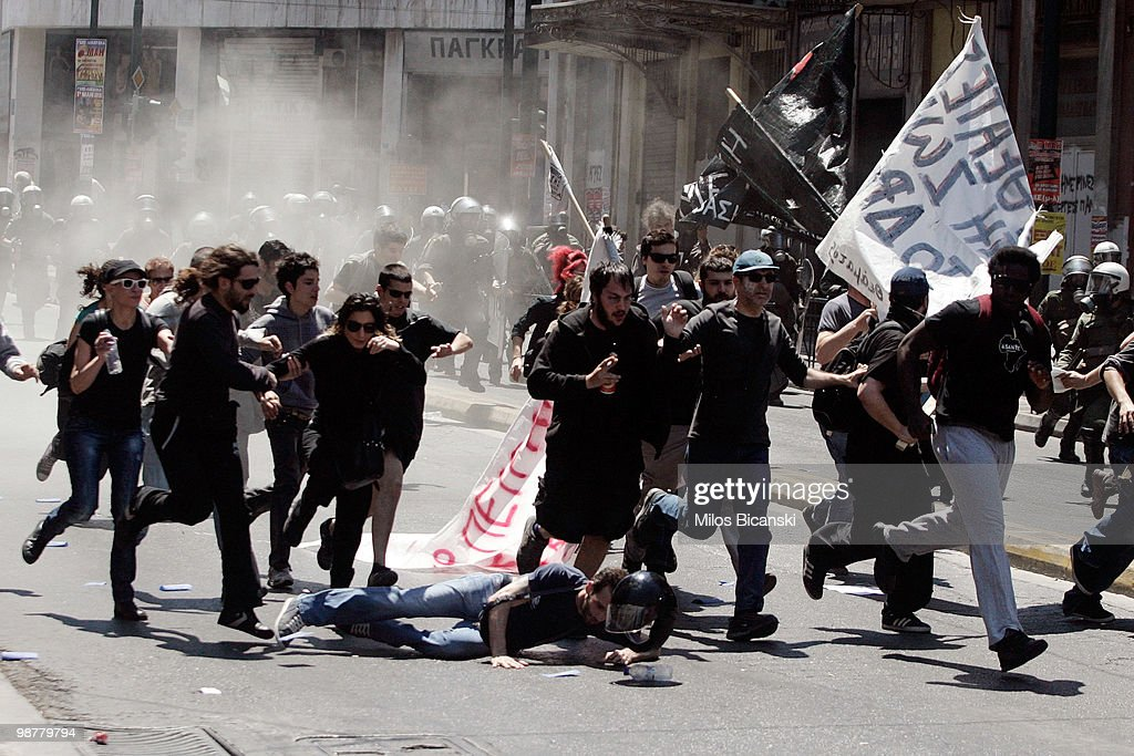 Protesters run from riot police during May Day protests on May 1, 2010 in Athens, Greece. Thousands of protesters gathered in Athens and other Greek cities to participate in May Day rallies, angered by the harsh austerity measures demanded by the EU. Reports suggest that the 45 billion euros ($60 billion) already pledged by the International Monetary Fund and European Union will be insufficient to tackle Greece's mounting debt crisis.