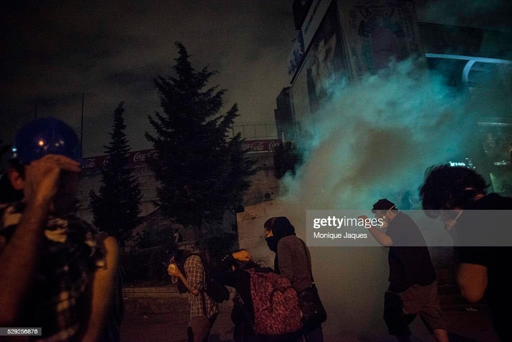 Protesters run from tear gas On the 6th day of protests in Istanbul Opposition groups fight in the Dolmabache area of the city where the Prime...